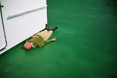 dead to the world (lomokev) Tags: man male green ship floor sleep bald minimal contax deck normandie agfa normandy t2 agfaultra contaxt2 deadtotheworld file:name=070823contaxt210