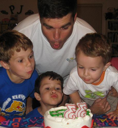 Patrick blows out his candles with P.J., Nick-Nick and Charlie