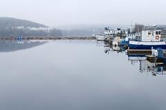 U t u i n e n (Pörrö) Tags: lake water fog suomi finland boats mirror spring still harbour gray calm jyväskylä 2010 satama järvi sumu kevät jyväsjärvi