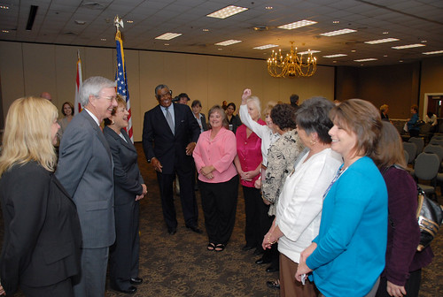 Chilton County's Gold Award winning Jemison Elementary School Food Service Staff sing a HealthierUS School Challenge jingle to Janey Thornton, USDA Food, Nutrition and Consumer Services Deputy Under Secretary (3rd from left), and Dr. Joseph B. Morton, Alabama State Superintendent of Education (2nd from left) while others look on at Alabama's celebration event that recognized 52 of their schools for meeting the challenge on Oct. 29, 2010.
