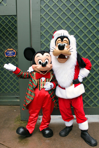 Mickey Mouse and Goofy dressed up for Christmas