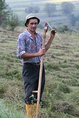 Cleaning the Blade (romaniashots) Tags: morning man work walking village romania villager scythe haying interestingness225 i500 rimetea romaniashots