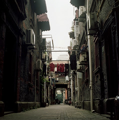 Alley of Shanghai ( ken ) Tags: china street shadow sky 120 6x6 film alley shanghai minolta kodak laundry portra400nc    autocord    galleryphoto