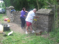 Local volunteer stonemasons applying the finishing touches to the restored bridge