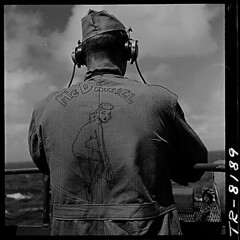"Pfc. Elmer McDaniel, USMC, decorated back of his work jumper with what he called a ""Jawja"" peach. On board the USS Lexington (CV-16)., ca. 11/29/1943 (The U.S. National Archives) Tags: bw usmc private marine ship usslexington aviation wwii worldwarii headphones marines pto aircraftcarrier usnavy usn marinecorps warship steichen secondworldwar worldwartwo unitedstatesmarinecorps navalaviation unitedstatesnavy usmarines pacifictheatre mcdaniel pacifictheater usmarinecorps unitedstatesmarines edwardsteichen georgiapeach privatefirstclass essexclass usslexingtoncv16 cv16 cvt16 pacifictheaterofoperations usnationalarchives pacifictheatreofoperations edwardjsteichen avt16 cva16 nara:arcid=520880 pfcelmermcdaniel pfcmcdaniel elmermcdaniel usslexingtoncva16 usslexingtoncvs16 cvs16 usslexingtoncvt16 usslexingtonavt16"