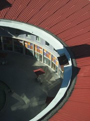 Red curved roof (peggyhr) Tags: blue red summer orange white canada lines sunshine reflections grey shadows bc curves shapes burnaby crystalmall beautifulcapture peggyhr