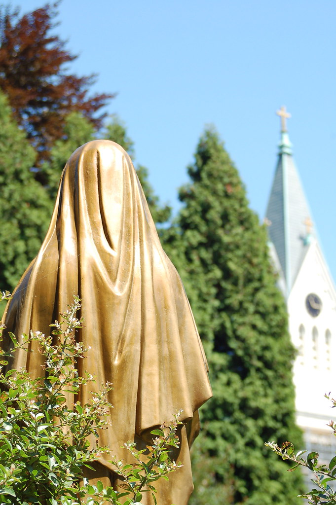 Rear view of nun statue