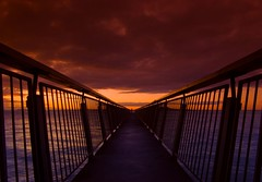 Dawn Passage (Light Knight) Tags: ocean red sea newzealand sky orange sunrise warning dawn early saturated land cokin instantfave mywinners aplusphoto p124 sherphard pentaxk10d1645