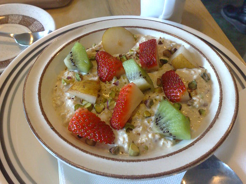 bircher muesli with pistachio, kiwi fruit & strawberries