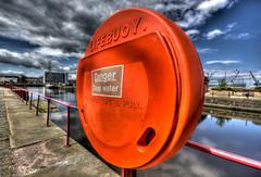 Lifebuoy (elementalPaul) Tags: red sky orange water catchycolors scotland dock edinburgh pentax tripod leith lifebuoy hdr buoy sigma1020mm portofleith photomatixpro 5xp k10d pentaxk10d princeofwalesdock