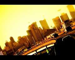 167/365 (Melgo2K (soo busy)) Tags: city light sunset sun cars yellow dark san francisco bright structures beam freeway rays scape