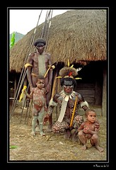 Chief of the Village... (Manon van der Lit) Tags: travel family portrait people man men children indonesia village dani tribal tribe papua indonesie newguinea primitive koteka irianjaya baliemvalley papoea tibal penisgourds baliemvallely manonvanderlit