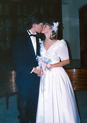 Wedding Kiss (Rock Steady Images) Tags: flowers wedding ontario canada church paul kiss dress piano husband scan tuxedo wife irene 1989 peterborough 50views firstkiss 25views bypaulchambers rocksteadyimages