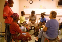Liberian Translator explaining the admissions process in the Hospital