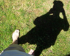 Me and my Stalking Shadow (Tomitheos) Tags: shadow portrait sun selfportrait toronto green feet me grass self flickr poetry poem image bodylanguage august pic daily shade barefoot stalker barefeet now today stalking rhyme homme 2007 homens ombres stockphotography ontariocanada supershot i posr  tomitheos griffinpoetryprize tomlinardos poemspoetrylyrics photographwithapoem songstopics