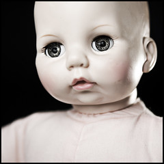 Doll 2 (Brandon Robbins) Tags: pink light color face toy scary eyes doll dof looking babydoll muted