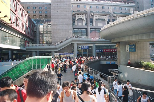 Thousands of people crowd the surroundings of the Beijing West Train Station.