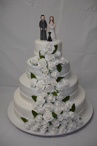 Nothing says wedding cake like a white fire tiered cake with the bride and