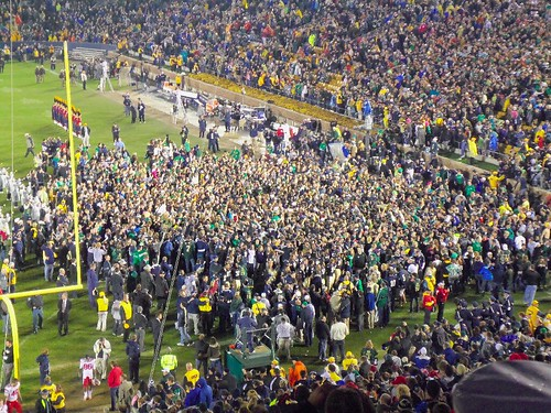 Notre Dame fans rush the field as if they had just won a championship, not their fifth win of the season.