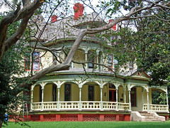 Wraparounds (Texas Finn) Tags: windows red chimney white brick green glass yellow architecture stairs concrete woodwork paint doors texas decorative palestine painted scrollwork bracket steps victorian gingerbread stainedglass historic stained porch frame mansion trim majestic chimneys gable stately porches detai millwork foundatin threestory platinumphoto anawesomeshot flickrelite preservatin