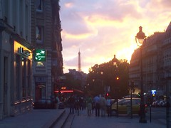 The sun sets over Paris