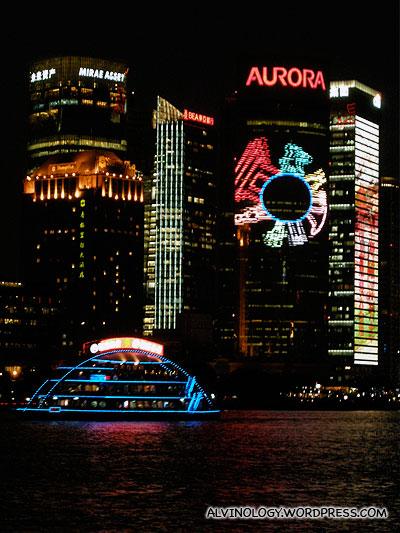Illuminated ship against illuminated backdrop