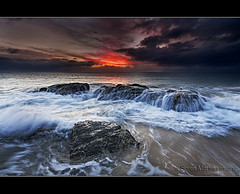 Wave Action at Sunrise (danishpm) Tags: seascape beach clouds sunrise canon waterfall rocks wave australia wideangle explore qld aussie aus 1020mm frontpage manfrotto sigmalens tugun eos450d 450d yourwonderland sorenmartensen hitechgradfilter 09ndreversegrad