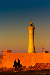 Couple in front of the Lighthouse (Beum Gallery) Tags: ocean sunset sea mer lighthouse atlantic morocco maroc phare rabat atlantique coucherdusoleil ocan