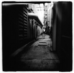 The alleyway (Otto K.) Tags: city atlanta light urban bw 6x6 film mediumformat georgia blackwhite holga alley downtown pipe retro grayscale decayed 120n darkroomprint ottok rolleiretrofilm