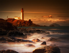 Turnberry Lighthouse and Ailsa Craig (BoboftheGlen) Tags: uk sea lighthouse castle robert beach golf island coast scotland clyde championship rocks long exposure king waves open britain bruce tide great course stevenson shore craig british earl ailsa ayr contrails beacon carrick firth ayrshire maidens turnberry culzean top20colorpix20