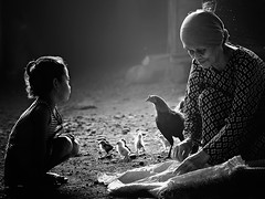 my grandma ... (Mat Padin) Tags: morning light bw white black chicken ray village grandmother suburban low granddaughter human activity kampung interest pagi putih luar cahaya ayam hitam nenek bandar cucuk