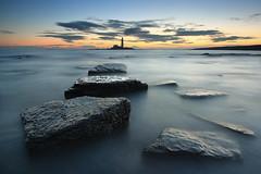 St. Mary's Lighthouse (Alistair Bennett) Tags: lighthouse seascape sunrise coast rocks polarizer stmarys whitleybay tynewear oldhartley canonefs1022 gnd075he