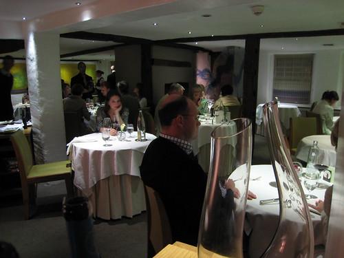 Restaurant interior, Girlie awaits her husband