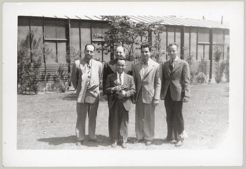 Five men pose