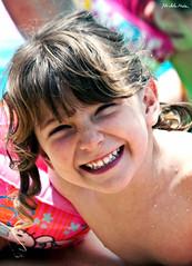 Smile =) (Michela Medda) Tags: baby smile estate piscina ricci sorriso sole bambina divertimento bionda frangia 450d bellagiornata braccioli 55250mm