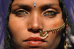 "'The eyes have it!"" Papu in Pushkar, India (Stuart-Cohen) Tags: woman india mystery eyes women purple nikond70 feminine indian makeup lips sensual jewelery elegant ethnic pushkar gypsy gypsies rajasthan papu indianwomen impressedbeauty 50millionmissing facesofportraits fiftymillionmissingwomen indiangypsies"