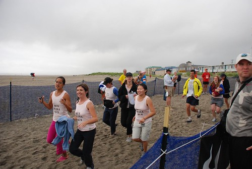 Olivia, Erica, Hien, Michelle, Keri, Sarah, Monroe, and Robin running to the finish