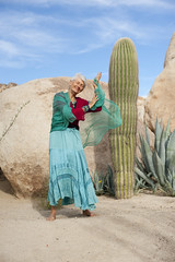 Graceful Senior Woman 2 (ElenaRay) Tags: new old blue cactus portrait sky woman senior beauty smile self outside happy dance healthy movement desert dancing natural spirit free style jewelry grace health age seventy hippie strength organic wisdom spiritual aging 70 graceful fit active turqoise southwestern esteem maturity