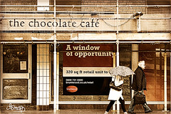 Window of opportunity (DevilFishMark) Tags: people woman man shop umbrella closed scaffold 2010 a700 windowofopportunity chocolatecafe