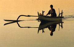 1998 Fisherman at Sunrise (anoldent) Tags: light bali silhouette reflections golden boat outrigger