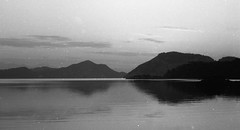 Waking up in........ (Gremxul) Tags: sea sky blackandwhite bw black reflection film water monochrome silhouette clouds composition contrast 35mm island mare olympus om10 shades analogue reflexions olympusom10 blackwhitephotos canon8800f gremxul