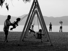 swing.me (alefbetac) Tags: bw mountains beach kids swings calm greece peloponissos elaionas alefbetac