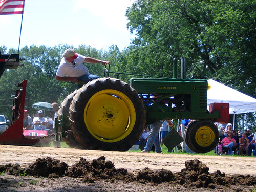 an old pro and his trusty john deere