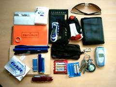 Items I Carry (krasi) Tags: sunglasses notebook keys phone wallet knife mp3 player ring lighter pens orbit batteries notepad