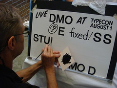 John downer paints Helvetica by hand