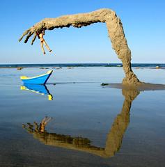 who has the upper hand now? (sandcastlematt) Tags: submergedsandmonster sandhand sand castle sculpture sandcastle sandsculpture woody adventuresofwoody reflection beach duxbury duxburybeach massachusetts bostonist universalhub toys boat toyboat