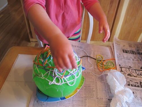 Peelu applying her goopy yarn strings