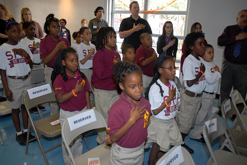 Students from Success Preparatory Academy lead the pledge of allegiance at the kick-off of the No Kid Hungry campaign in New Orleans on November 12.
