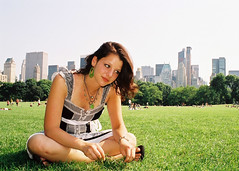 Central Park Skyline (FatKid23) Tags: nyc newyork cute beautiful model pretty sitting wind centralpark greeneyes nyskyline blackhair griffo necklece kristinagriffo