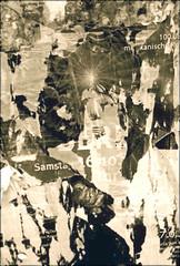 mystic light (piktorio) Tags: street light wallpaper bw berlin kreuzberg paper de ripped torn typo toned decollage calinago seenreadypaint
